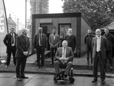 From left to right: Captain John Clifton, The Reverend Anthony Ball, Emmanuel Gotora, Stephen Serrant, Andy Hill, Lieutenant Colonel Drew McCombe, Tom Hill, Eddie Hughes MP, The Reverend Dr James Hawkey